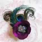 Magenta silk peacock feather corsag..