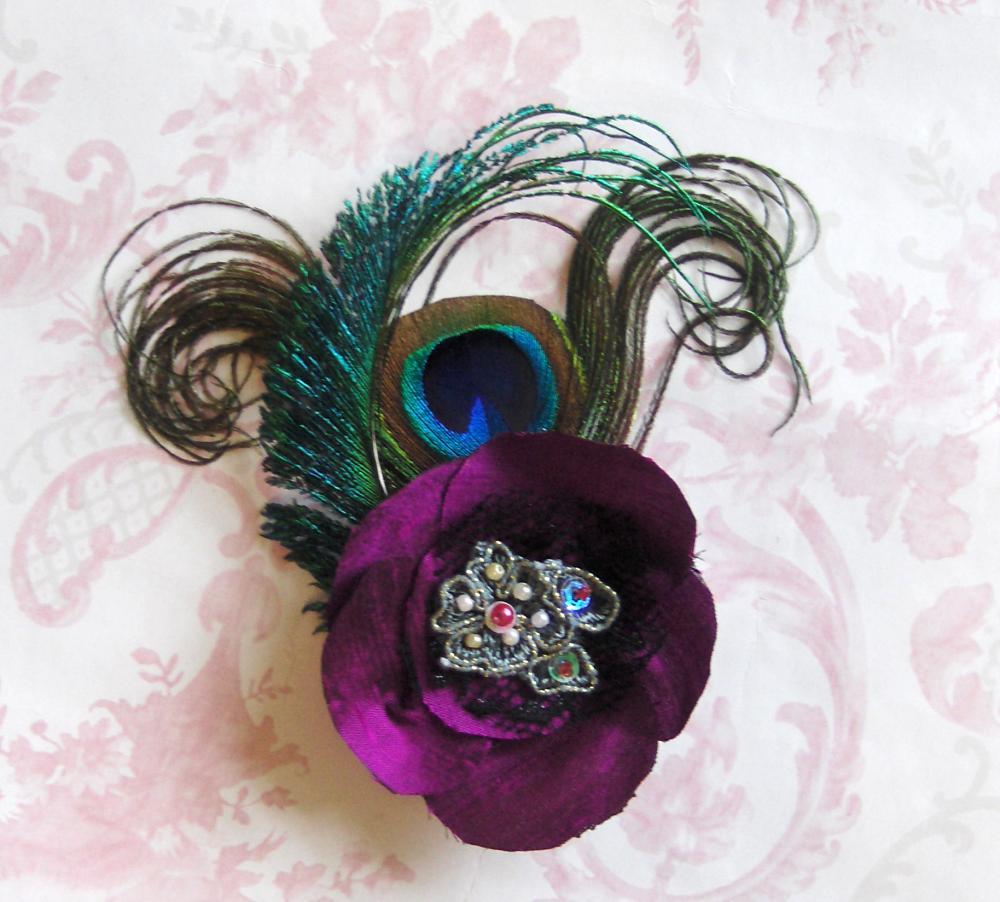 Magenta silk peacock feather corsage.