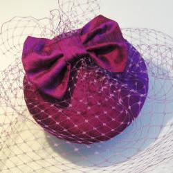 Magenta Silk Bow Veiled Cocktail Hat.